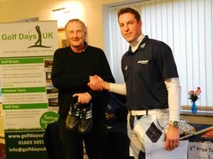 Winner Steve Greatrex receiving his prizes