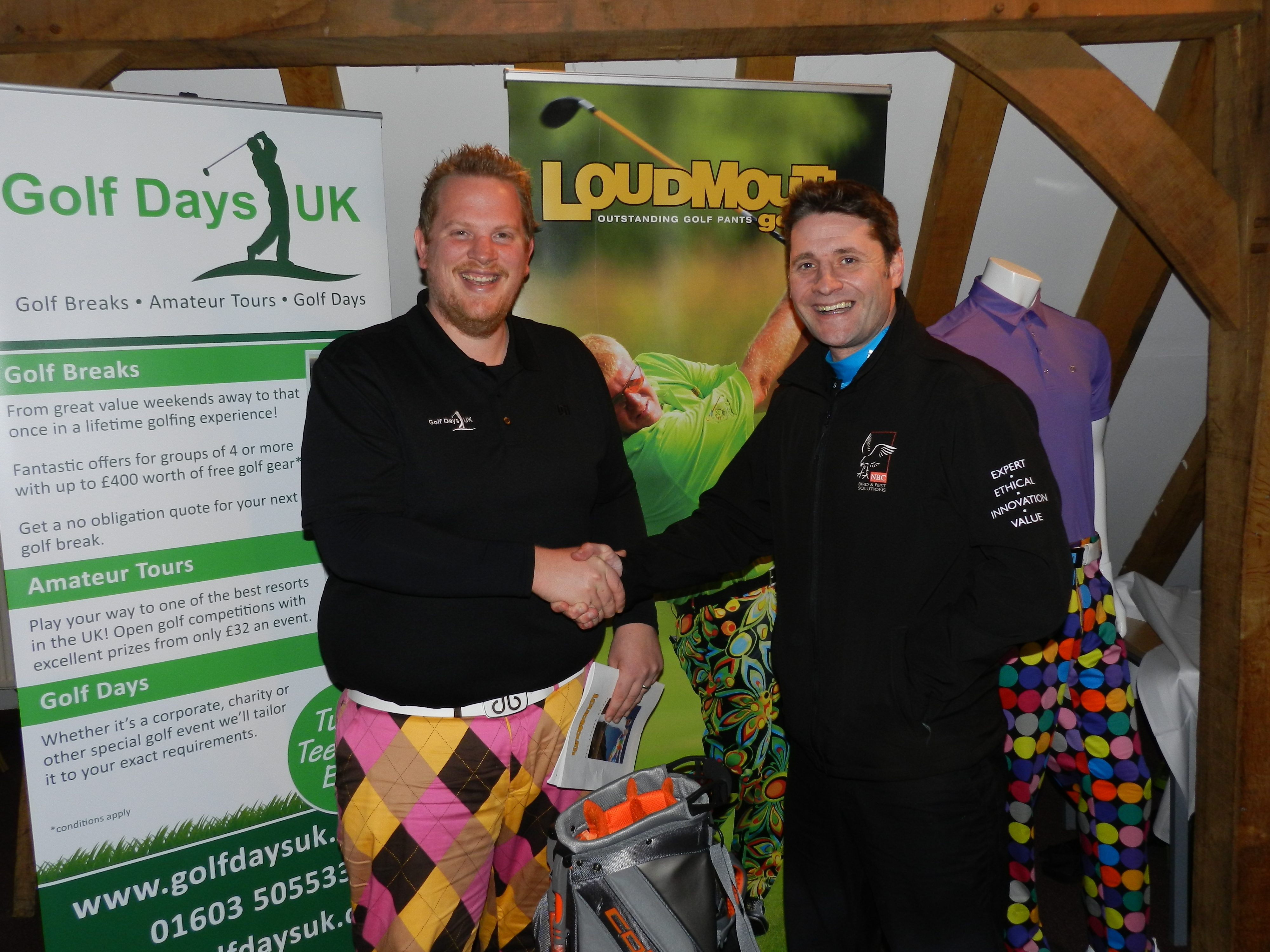 Winner Stuart Miller (right) collects his prize